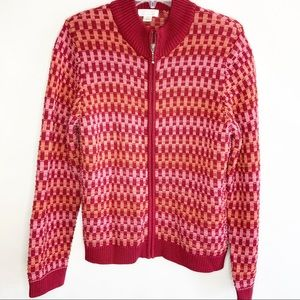 Zip front cardigan in veriagated reds. Large.